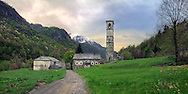 The old stone houses and bell tower of Fondo, - which literally means bottom - the very last village of the Valchiusella, a small valley in the Western Alps in Piedmont, Italy, an enchanted place where time seems to have stopped. Taken at sunset, this is a stitch of seven vertical takes.