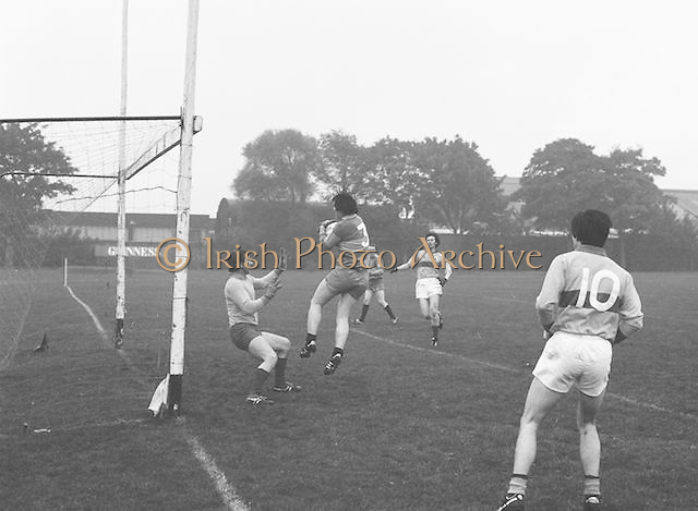 The Guinness goalie blocks the goal as the Garda player attempts to get passed him during the Guinness v Garda Gaelic Football Club Tournament Final on the 14th October 1979.