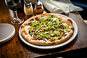 SHOT 3/15/17 2:02:21 PM - Pizza Republica's Duck and Fig Pizza $18 with Confit Duck, Fresh Fig, Wild Arugula, Port Pickled Red Onion and Fresh Mozzarella. Pizza Republica is a charming Italian trattoria in the Denver Tech Center and downtown Denver, Co. featuring authentic wood-fired Neapolitan pizza, regional Italian cuisine and an extensive Italian focused wine list. (Photo by Marc Piscotty / © 2017)