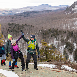 Hikers on the ledges on Huckleberry Mountain in South Johnsburg, New York. Adirondack Mountains.