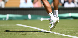 LONDON, ENGLAND - Monday, July 1, 2019: The Asics tennis shoes and Lacoste socks of Novak Djokovic (SRB) during the Gentlemen's Singles first round match on Day One of The Championships Wimbledon 2019 at the All England Lawn Tennis and Croquet Club. (Pic by Kirsten Holst/Propaganda)