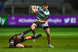 Newcastle Falcons' Adam Radwan evades the tackle of Dragons' Dan Babos<br /> <br /> Photographer Craig Thomas/Replay Images<br /> <br /> EPCR Champions Cup Round 4 - Newport Gwent Dragons v Newcastle Falcons - Friday 15th December 2017 - Rodney Parade - Newport<br /> <br /> World Copyright © 2017 Replay Images. All rights reserved. info@replayimages.co.uk - www.replayimages.co.uk