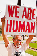 14 MARCH 2011 - PHOENIX, AZ: A man marches in supports of immigration reform at the Arizona State Capitol in Phoenix Monday. Protests by immigrants' rights activists have continued as the state's conservative Republican legislators debate toughening the state's anti-immigrant bills. Some of the bills the state legislature has debated this year include eliminating birthright citizenship, a law that would require hospitals to check the immigration status of patients checking in for elective care, a bill that would require schools to verify the immigration status of students when they enroll and a bill that would require law enforcement to impound the cars of undocumented immigrants even if they have a legal driver's license from another state.      Photo by Jack Kurtz