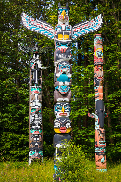 """Totem poles are monumental sculptures carved on poles, posts, or pillars with symbols or figures made from large trees, mostly western red cedar, by indigenous peoples of the Pacific Northwest coast of North America (northwestern United States and Canada's western province, British Columbia). The word totem derives from the Algonquian (most likely Ojibwe) word odoodem [oˈtuːtɛm], """"his kinship group"""". The carvings may symbolize or commemorate cultural beliefs that recount familiar legends, clan lineages, or notable events. The poles may also serve as functional architectural features, welcome signs for village visitors, mortuary vessels for the remains of deceased ancestors, or as a means to publicly ridicule someone. Given the complexity and symbolic meanings of totem pole carvings, their placement and importance lies in the observer's knowledge and connection to the meanings of the figures.<br /> <br /> Totem pole carvings were likely preceded by a long history of decorative carving, with stylistic features borrowed from smaller prototypes. Eighteenth-century explorers documented the existence of decorated interior and exterior house posts prior to 1800; however, due to the lack of efficient carving tools, sufficient wealth, and leisure time to devote to the craft, the monumental poles placed in front of native homes along the Pacific Northwest coast probably did not appear in large numbers until the late eighteenth or early nineteenth century. Trade and settlement initially led to the growth of totem pole carving, but governmental policies and practices of acculturation and assimilation sharply reduced totem pole production by the end of nineteenth century. Renewed interest from tourists, collectors, and scholars in the 1880s and 1890s helped document and collect the remaining totem poles, but nearly all totem pole making had ceased by 1901. Twentieth-century revivals of the craft, additional research, and continued support from the public have helped establish ne"""