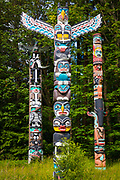 "Totem poles are monumental sculptures carved on poles, posts, or pillars with symbols or figures made from large trees, mostly western red cedar, by indigenous peoples of the Pacific Northwest coast of North America (northwestern United States and Canada's western province, British Columbia). The word totem derives from the Algonquian (most likely Ojibwe) word odoodem [oˈtuːtɛm], ""his kinship group"". The carvings may symbolize or commemorate cultural beliefs that recount familiar legends, clan lineages, or notable events. The poles may also serve as functional architectural features, welcome signs for village visitors, mortuary vessels for the remains of deceased ancestors, or as a means to publicly ridicule someone. Given the complexity and symbolic meanings of totem pole carvings, their placement and importance lies in the observer's knowledge and connection to the meanings of the figures.<br /> <br /> Totem pole carvings were likely preceded by a long history of decorative carving, with stylistic features borrowed from smaller prototypes. Eighteenth-century explorers documented the existence of decorated interior and exterior house posts prior to 1800; however, due to the lack of efficient carving tools, sufficient wealth, and leisure time to devote to the craft, the monumental poles placed in front of native homes along the Pacific Northwest coast probably did not appear in large numbers until the late eighteenth or early nineteenth century. Trade and settlement initially led to the growth of totem pole carving, but governmental policies and practices of acculturation and assimilation sharply reduced totem pole production by the end of nineteenth century. Renewed interest from tourists, collectors, and scholars in the 1880s and 1890s helped document and collect the remaining totem poles, but nearly all totem pole making had ceased by 1901. Twentieth-century revivals of the craft, additional research, and continued support from the public have helped establish new interes"