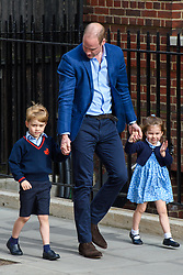 The Duke of Cambridge with Prince George and Princess Charlotte enter the Lindo Wing at St Mary's Hospital in Paddington, London. Photo credit should read: Matt Crossick/EMPICS Entertainment