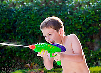 Kid playing with water toy in the summer.
