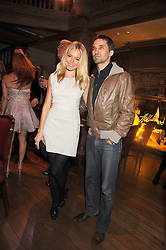 SIENNA MILLER and OLIVIER MARTINEZ at a party to celebrate the launch of Hollywood Domino - a brand new board game, held at Mosimann's 11b West Halkin Street, London on 7th November 2008.  The evening was in aid of Charlize Theron's Africa Outreach Project.