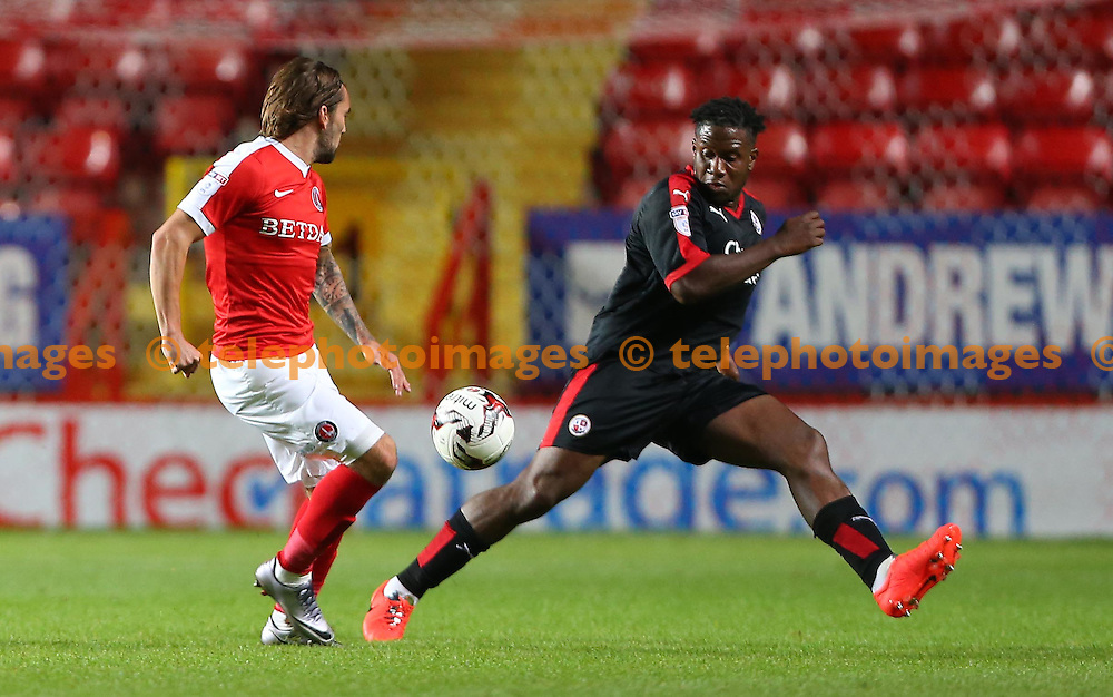 Crawley's Chris Arthur challenges Ricky Holmes of Charlton during the Checkatrade Trophy match between Charlton Athletic and Crawley Town at The Valley in London. October 4, 2016.<br /> James Boardman / Telephoto Images<br /> +44 7967 642437