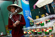 A Vietnamese woman sells cups of Che, the famous sweet dessert of Vietnam, Southeast Asia