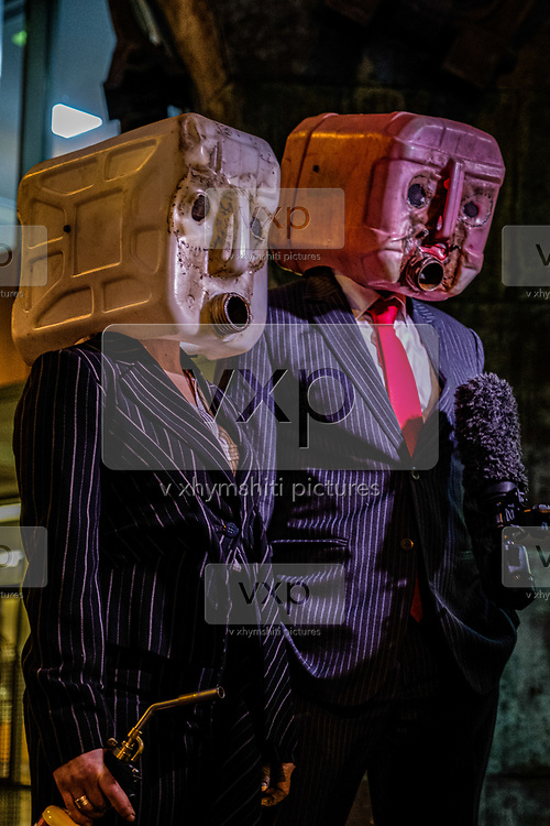 "Protesters wearing pinstripe suits and masks made from salvaged waste oil containers found washed up on a Cornish beach, speaks to the members of the press after they set fire to a Viking longship which bore a sail reading PARIS CLIMATE AGREEMENT in London, on Sunday, Nov 15, 2020. (VXP Photo/ João Daniel)<br /> <br /> ""We are experiencing cascading marine, geophysical and ecological breakdown. If we don't change our habits now, we will destroy our greatest resource, with unthinkable consequences says a statement on Sunday sent from Ocean Rebellion, an environmental activist group in London. Ocean Rebellion activists are seen in a ceremonial demonstrative activity which they called it as 'Viking Burial of IMO's lack of climate ambition'."