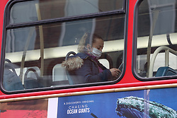 © Licensed to London News Pictures. 02/03/2021. London, UK. A woman wearing a protective face covering travelling on a London bus in north London. The number of Covid-19 infection rate and deaths have dropped more than a quarter within a week as the effect of lockdown restrictions and vaccine rollout is making an impact. Six cases of the P1 variant have been identified in people who recently returned from Brazil. Photo credit: Dinendra Haria/LNP