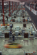 Fiat car engine factory, Turin, Italy. In the 1980's Fiat used automated carriers guided by wires in the floor to move engines from one assembly station to another: LAM.