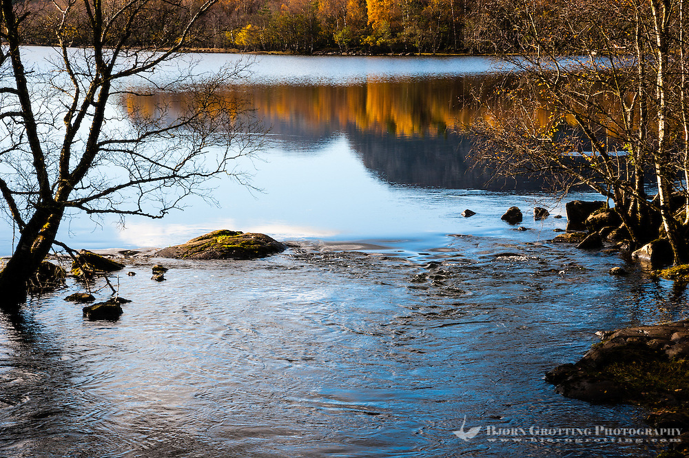 Imsvatnet, Sandnes, Norway. Colourful autumn colours, reflection and a running river.