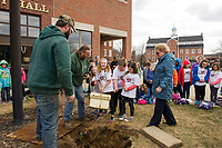 Laconia Public Works employees Tyler Smith and Dan Camire (on left) with Pam Clark (on right) look on as PSS 3rd grade students Lucy Dudek, Ellen Valovanie, Riley Wilson and Olivia Cotnoir lift the time capsule out of the ground in the front of Laconia City Hall on Wednesday afternoon.  (Karen Bobotas/for the Laconia Daily Sun)