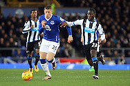 Ross Barkley of Everton is chased by Henri Saivet of Newcastle United. Barclays Premier League match, Everton v Newcastle United at Goodison Park in Liverpool on Wednesday 3rd February 2016.<br /> pic by Chris Stading, Andrew Orchard sports photography.