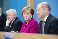 12 MAR 2018, BERLIN/GERMANY:<br /> Horst Seehofer (L), CSU, desig. Bundesinnenminister, Angela Merkel (M), CDU, Bundeskanzlerin, und Olaf Scholz (R), SPD, desig. Bundesfinanzminister, waehrend einer Pressekonferenz zum Koalitionsvertrag der CDU/CSU und SPD, Bundespressekonferenz<br /> IMAGE: 20180312-01-007