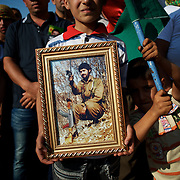August 12, 2012 - Kafa Safra, Efrin, Syria: Around five thousand Syrian Kurdish attended the funeral and ceremony of martyrdom of Taliz Gadalum, a Kurdistan Workers' Party (PKK) fighter killed days earlier during combat against the Turkish army. PKK has been fighting an armed struggle against the Turkish state for an autonomous Kurdistan and greater cultural and political rights for the Kurds in Turkey, Iraq, Syria and Iran. Founded on 27 November 1978 in the village of Fis, was led by Abdullah Öcalan. The PKK's ideology was originally a fusion of revolutionary socialism and Kurdish nationalism - although since his imprisonment, Öcalan has abandoned orthodox Marxism. The PKK is listed as a terrorist organization by Turkey, the United States, the European Union and NATO. (Paulo Nunes dos Santos)