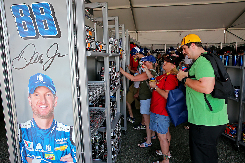 Apr 30, 2017; Richmond, VA, USA; Fans look at merchandise for NASCAR Cup Series driver Dale Earnhardt Jr. (88) before the Toyota Owners 400 at Richmond International Raceway. Mandatory Credit: Peter Casey-USA TODAY Sports