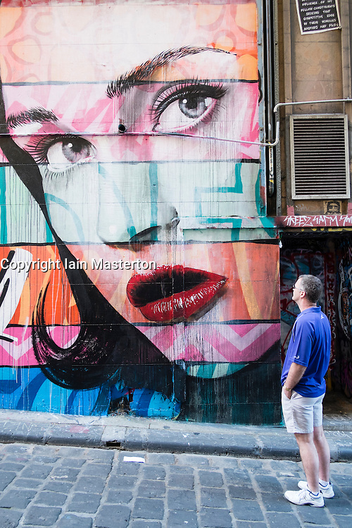 Street art painted on building wall in central Melbourne Australia
