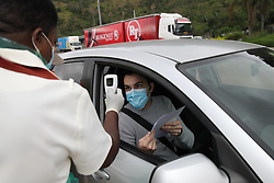 South Africa - Durban - 04 May 2020 - A health worker checks the temperature of a motorist during the compliance monitoring at Marianhill toll plaza on Monday morning<br /> Picture: Doctor Ngcobo/African News Agency(ANA)