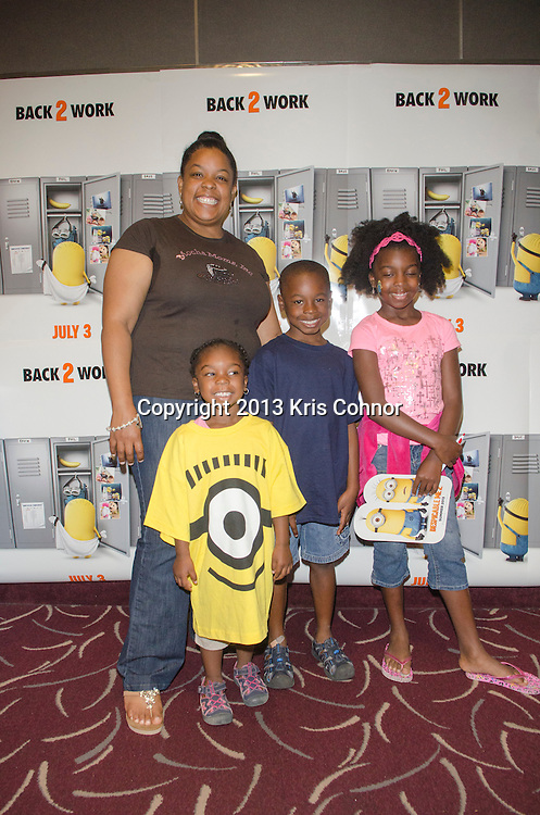 WASHINGTON DC JUNE 29: Children with their parents participate in games and a screening of the upcoming movie Despicable Me 2 at AMC  Mazza Gallerie in Washington DC on June 29, 2013.<br /> Photo by Kris Connor/Universal Pictures