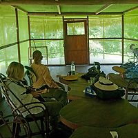 Travelers relax in the Amazon Refuge Wildlife Conservation Center by Peru's Yanayacu River.