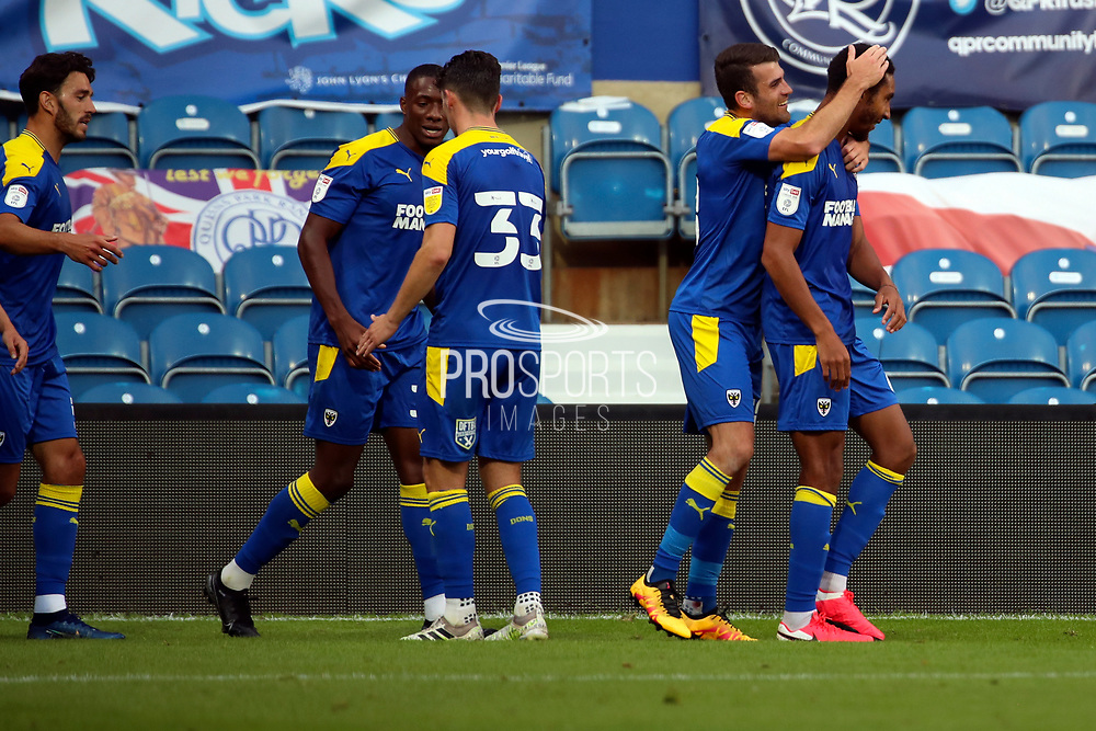 AFC Wimbledon defender Terell Thomas (6) celebrating after scoring goal to make it 2-1 with AFC Wimbledon attacker Adam Roscrow (10) during the EFL Trophy Group O match between AFC Wimbledon and Charlton Athletic at the Kiyan Prince Foundation Stadium, London, England on 1 September 2020.