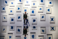 October 8, 2018 - London, United Kingdom - British artist, Idris Khan OBE, with his large-scale artwork '21 Stones', made up of 21 paintings on paper at the British Museum. The work has been commissioned by the British Museum for the new Albukhary Foundation Gallery of the Islamic World, which opens to the public on 18 October. (Credit Image: © Dinendra Haria/i-Images via ZUMA Press)