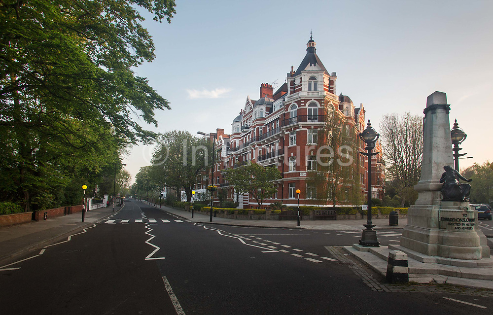 Abbey Road zebra crossing on 16th April 2020 in London, United Kingdom. Normally crowded with people London is like a ghost town as workers stay home under lockdown during the Coronavirus pandemic. The image shot here in 1969 next to the studios where their classic album was recorded of the Beatles crossing Abbey Road, became one of the most famous album covers in history. Shortly after the albums release, the cover became part of the Paul is dead theory that was spreading across college campuses in the US. According to followers of the rumour, the cover depicted the Beatles walking out of a cemetery in a funeral procession. The escalation of the Paul is dead rumour became the subject of intense analysis on mainstream radio and contributed to Abbey Roads commercial success in the US.. The crossing has since become a popular destination for Beatles fans and the crossing was given grade II listed status for its cultural and historical importance.