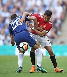Chelsea's Cesar Azpilicueta (left) and Manchester United's Alexis Sanchez battle for the ball