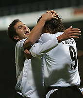 Photo: Lee Earle.<br /> Portsmouth v Chelsea. The Barclays Premiership.<br /> 26/11/2005. Joe Cole congratulates Hernan Crespo after he opened the scoring for Chelsea.