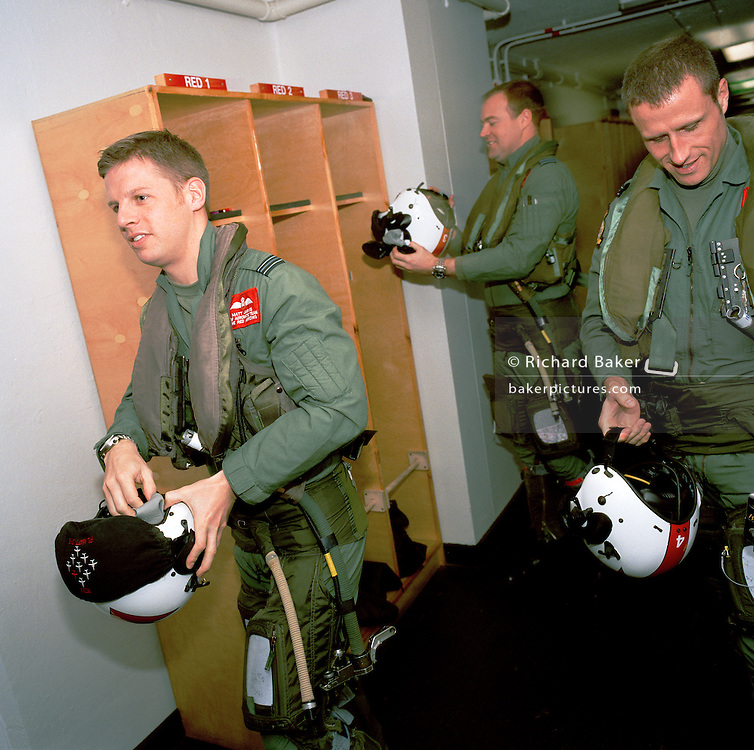 Pilots of the 'Red Arrows', Britain's Royal Air Force aerobatic team leave base before another winter training sortie.