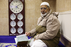 © Licensed to London News Pictures. 07/02/2015. Leeds, UK. An elderly man reads inside Leeds Grand Mosque in West Yorkshire as mosques all over Britain open their doors to non-muslims to explain their faith beyond the hostile headlines. This is the second 'Visit My Mosque Day' with the first being last year. Organised by the Muslim Council of Britain, last year's event attracted hundreds of visitors for tours, talks and tea. Photo credit : Ian Hinchliffe/LNP