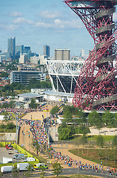 © Licensed to London News Pictures. 19/07/2015. City, UK. A general view of the Queen Elizabeth Olympic Park with the ArcelorMittal Orbit and the Olympic Stadium in sight as the Morrisons Great Newham London Run takes place today around the park. All runners in the 10k ran inside the Olympic Stadium and crossed the famous finish line and running track, which saw Olympic greats Usain Bolt, Jessica Ennis-Hill and Mo Farah race across in 2012. Photo credit : Isabel Infantes / LNP