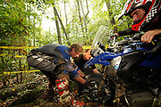 Brad & Kevin pull front wheel of R1200GS out of hole while Jason struggles to push with the bars.