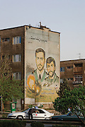 "Mural commemorating martyrs of the Iran-Iraq war (1980-1988). It reads ""Martyrdom is the art of the men of God"". Imam Khomeini"" and ""Generals Shiroodi and Keshvari"". Tehran, Iran, 2008"
