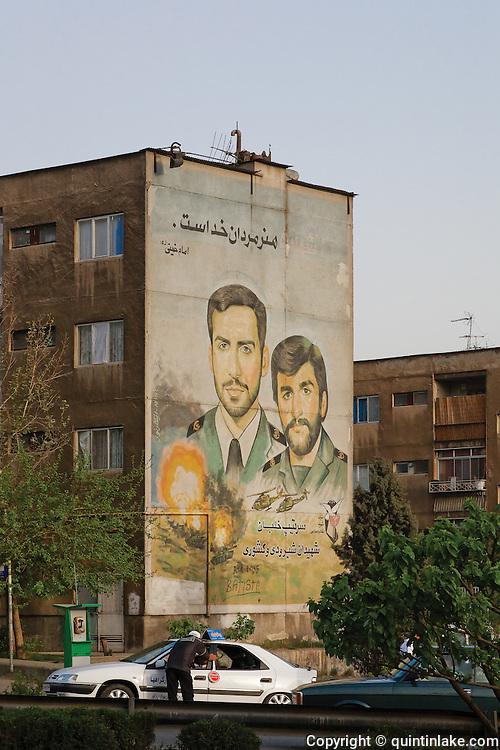 "Mural commemorating martyrs of the Iran-Iraq war (1980-1988). It reads ""Martyrdom is the art of the men of God"". Imam Khomeini"" and ""Generals Shiroodi and Keshvari"". Tehran, Iran, 2008"