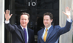 File photo dated 12/05/10 of Prime Minister David Cameron (left) with Deputy Prime Minister Nick Clegg on the steps of 10 Downing Street in London. Nick Clegg has lost his Sheffield Hallam seat to Labour.