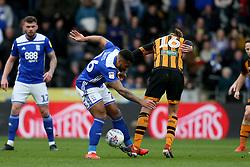 Birmingham City's David Davis (cenre) and Hull City's Jackson Irvine battle for the ball