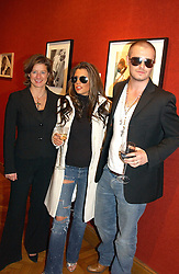 Left to right, photographer ALISON JACKSON with David & Victoria Beckham lookalikes at an aution of art inspired by footballer David Beckham in aid of The National Deaf Children's Society and held at Christie's, St.James's, London on 4th November 2004.<br />