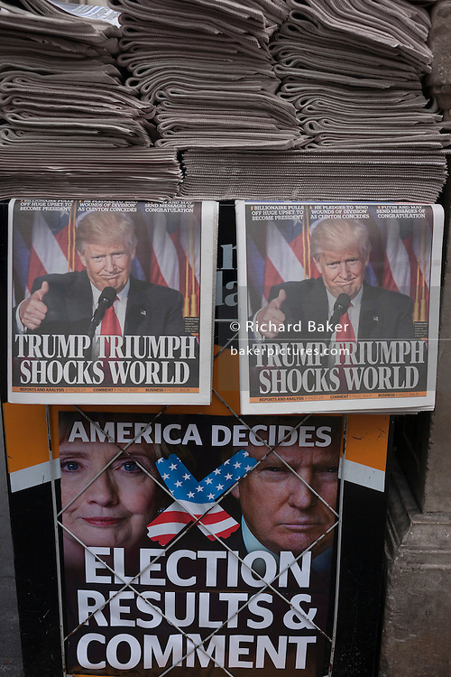 "London, 9th November 2016: US president-elect, Donald Trump appears on the front page of the London Evening Standard newspaper at Oxford Circus, London, on the day of his election. The headline reads ""Trump Triumph Shocks World"" and Londoners of all colours and races take the free paper to read the latest overnight news. © Richard Baker / Alamy Live News"