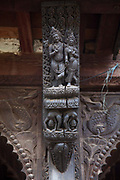 Wood carvings depicting extracts from the Kama Sutra on a small temple forming a part of Pashupatinath Temple complex.