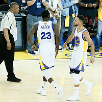 04 June 2017: Golden State Warriors forward Draymond Green (23) celebrates with Golden State Warriors guard Stephen Curry (30) next to referee Tony Brothers (25) during the Golden State Warriors 132-113 victory over the Cleveland Cavaliers, in game 2 of the 2017 NBA Finals, at the Oracle Arena, Oakland, California, USA.