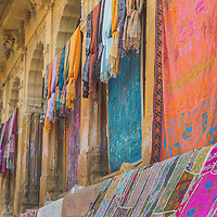 Colorful fabrics line the courtyards and alleyways of Jaisalmer, the Golden City of Rajasthan.