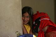 Inhauma_MG, Brasil...Folia de Reis em uma casa no Distrito dos Maias em Inhauma, na foto uma pessoa com adereco brincando com uma garota...Folia de Reis in a house in the Distrito dos Maias in Inhauma, in this photo a person with the typical fantasy playing with a girl...Foto: LEO DRUMOND / NITRO