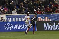 March 13, 2018 - Harrison, New Jersey, United States - Bradley Wright-Phillips (99) of Red Bulls & Damian Perez (15) of Club Tijuana fight for ball during Scotiabank Concacaf Champions League quarterfinal second leg game at Red Bull Arena Red Bulls won 3 - 1 (5 - 1 on aggregate) (Credit Image: © Lev Radin/Pacific Press via ZUMA Wire)