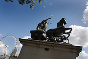 Queen Boudicca's (also Boadicea) statue and the 135m high London Eye, seen from the Westminster side of the River Thames.