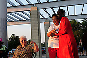 Avis Coleman (R to L) greets Vanessa Molina while they gather with fellow Catholics for a sunrise mass at Rainbow Beach on the city's south side to pray for peace and non-violence during the upcoming school year. The event hosted by The Black Catholic Deacons in the Archdiocese of Chicago is one of six simultaneous masses along Chicago's lakefront. August 25, 2012 l Brian J. Morowczynski~ViaPhotos...For use in a single edition of Catholic New World Publications, Archdiocese of Chicago. Further use and/or distribution may be negotiated separately. Contact ViaPhotos at 708-602-0449 or email brian@viaphotos.com.