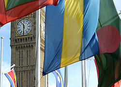 ©London News pictures. 14/03/11. The clock face of Big Ben can be seen through flags. Flags in London's Parliament Square today (Mon 14/03/11) celebrating Commonwealth Day. Picture Credit should read Stephen Simpson/LNP